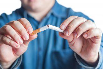 Quit smoking, human hands breaking the cigarette